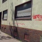 Putzwand vor Graffiti Entfernung